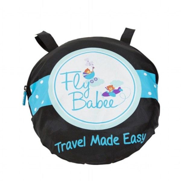 En mor opfinder en baby soveplads til flyrejser